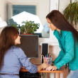 Two women in office — Stock Photo