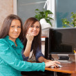 Two women using PC — Stock Photo #10530237