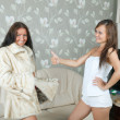 Woman shows new fur coat — ストック写真