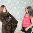 Woman  make boast of fur coat — Stok fotoğraf