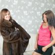 Woman make boast of fur coat — Stock Photo