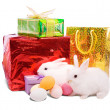 Stock Photo: White easter rabbits with gifts