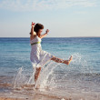 Happy  woman at sea  coast - Stock Photo