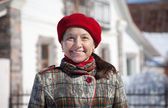 Mature woman against real estate in winter — Stok fotoğraf