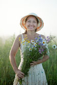 Woman with flowers posy — Stock Photo
