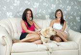 Women with labrador retriever in home — Stock Photo