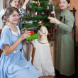 Family decorating Christmas tree at home — Stock Photo #8090631