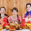 Foto Stock: Women eating pancake with tea