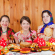 Royalty-Free Stock Photo: Women  eating pancake during  Shrovetide