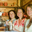 Women near  traditional russian samovar — Stock Photo