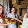 Stock Photo: Women with country meal