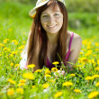 Stock Photo: Freckle womrelaxing in dandelion