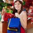Girl with christmas gifts - Stok fotoğraf