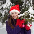 Woman in Santa hat outdoor — Stock Photo