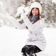 Girl throwing snow  in the air — Stock Photo #8094422