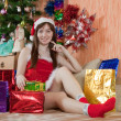 Girl with christmas gifts — Stock Photo #8094453
