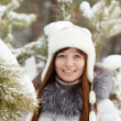 Smiling woman in wintry park — Stock Photo