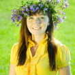 Girl in flowers wreath — Stock Photo #8094543