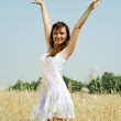 Girl  in white dress at cereals - Stock Photo