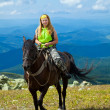 Rider on horseback at mountains — Stock Photo #8095469