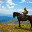 Tourist on horseback at mountains — Stock Photo #8095496