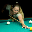 Woman plays russian billiards - Stok fotoğraf