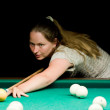 Woman playing billiard - Stok fotoğraf