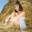 Stock Photo: Country girl on fresh hay