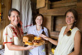 Women with country meal — Stock Photo
