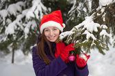 Woman in Santa hat outdoor — Stok fotoğraf