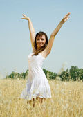 Girl in white dress at cereals — Stock Photo