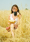 Girl with beer and bread — Stock Photo