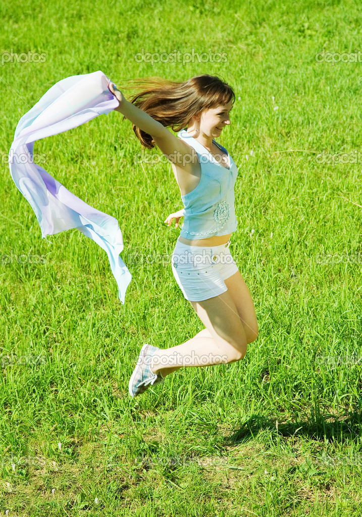 Jumping girl against summer meadow in summer day — Stock Photo #8094532