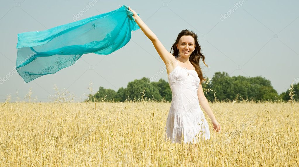 Happy girl in white dress at cereals field in summer — Stock Photo #8094579