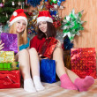 Happy girls celebrating Christmas — Stock Photo