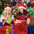 Girls with christmas gift — Stock Photo