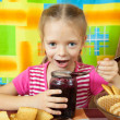 Stock Photo: Little girl eating marmalade