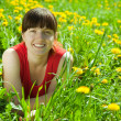 Happy woman in grass — Stock Photo