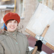 Womwith shovel in winter — Stock Photo #8139217