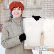 Woman with shovel in winter — Stock Photo