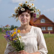 Woman in camomile chaplet — Stock Photo