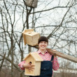 Woman with  new birdhouses - Stock Photo
