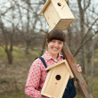 Woman with two  birdhouses - Stock Photo