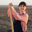 Stock Photo: Farmer in plowed field