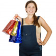 Pregnant woman with shopping bags — 图库照片