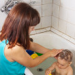 Mother wasing her baby - Stock Photo