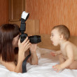 Mother with baby takes photo — Stock Photo