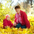 Mother and baby in autumn park — Stock Photo