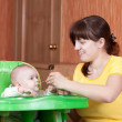 Mother feeding her daughter — Stock Photo #8139640