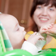 Mother feeding her 6 month daughter — Stock Photo #8139644